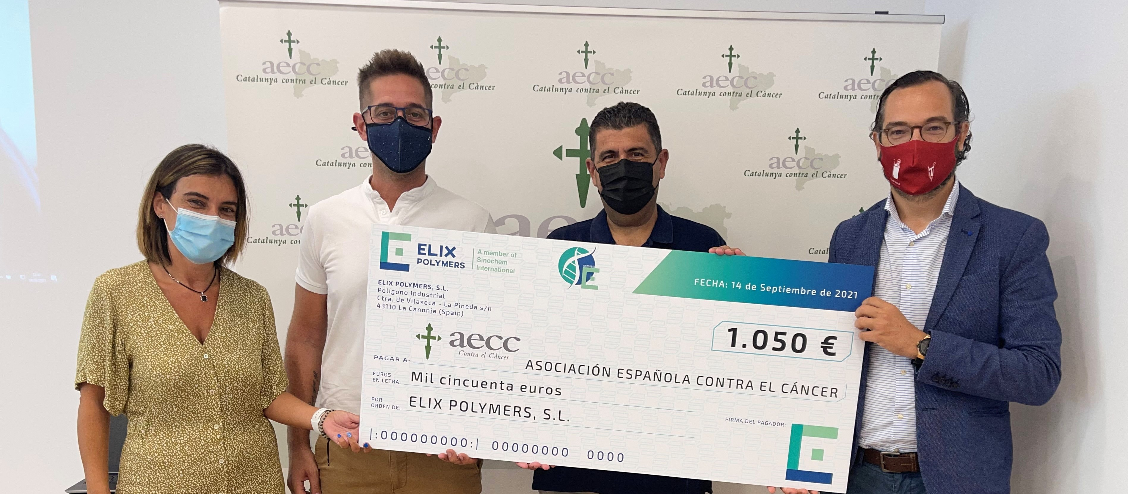 ELIX Polymers gives AECC a check for 1,050 euro